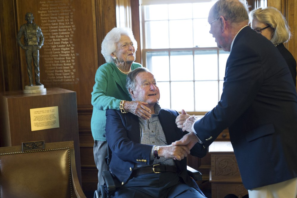 Former President George H.W. Bush, with his wife Barbara, speaks with former baseball teammate Richard Phelps on Wednesday during a visit to Phillips Academy in Andover, Mass. At right is Sally Phelps, Richard's wife.