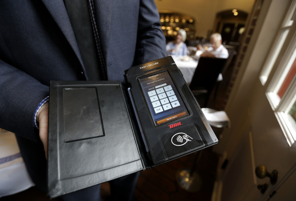 This tableside credit card processing device will be used at a New Orleans restaurant once microchip cards are phased in and magnetic-strip cards, which are easier for thieves to copy using stolen numbers, are phased out.