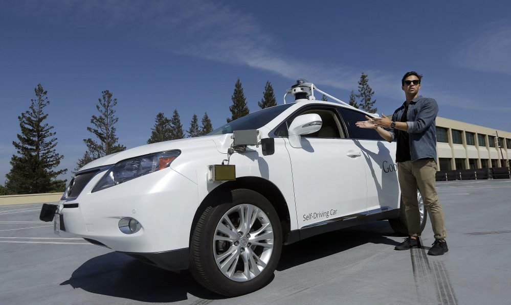 """Motorists may be able to more than just Google """"self-driving cars"""" if vehicles such as this SUV displayed by Brian Torcellini, Google team leader of driving operations, in Mountain View, Calif., can prove road worthy."""