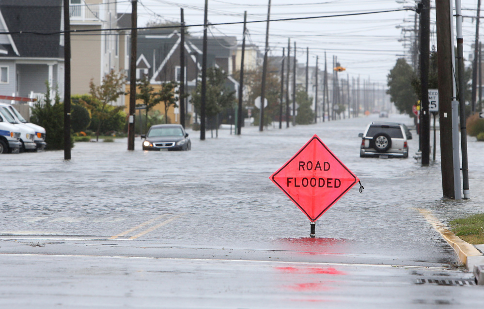 A car is stuck in floodwaters along Central Avenue in Sea Isle City, N.J., on Friday. New Jersey got pounded by heavy rain and strong winds that were expected to bring coastal flooding this weekend, even though the state is no longer in the anticipated path of Hurricane Joaquin. Lori M. Nichols/Gloucester County Times via AP