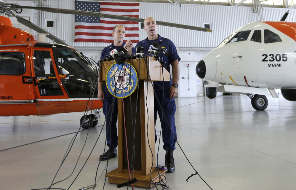 Capt. Mark Fedor, right, chief of response for the Coast Guard 7th District, offers an update on the search for crew members from the missing El Faro, with Lt. Cmdr. Gabe Somma, left, (who grew up in Portland, Maine) on Monday at the Opa-locka Airport in Opa-locka, Fla.