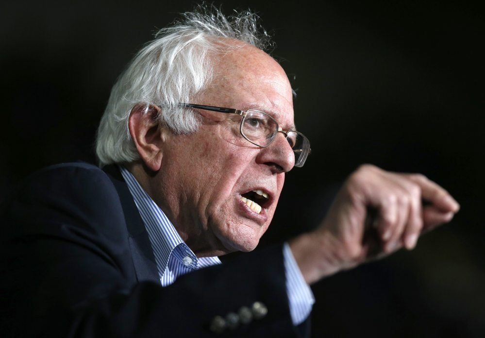 """Bernie Sanders speaks at a campaign rally Saturday in Springfield, Mass. He said in an interview, """"We have millions of working-class people who are voting for Republican candidates whose views are diametrically opposite to what voters want."""""""