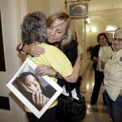 Debbie Ziegler holds a photo of her late daughter, Brittany Maynard, as she receives congratulations following the announcement that California would be the fifth state with a right-to-die law. Maynard, who had brain cancer, moved to Oregon to end her life.