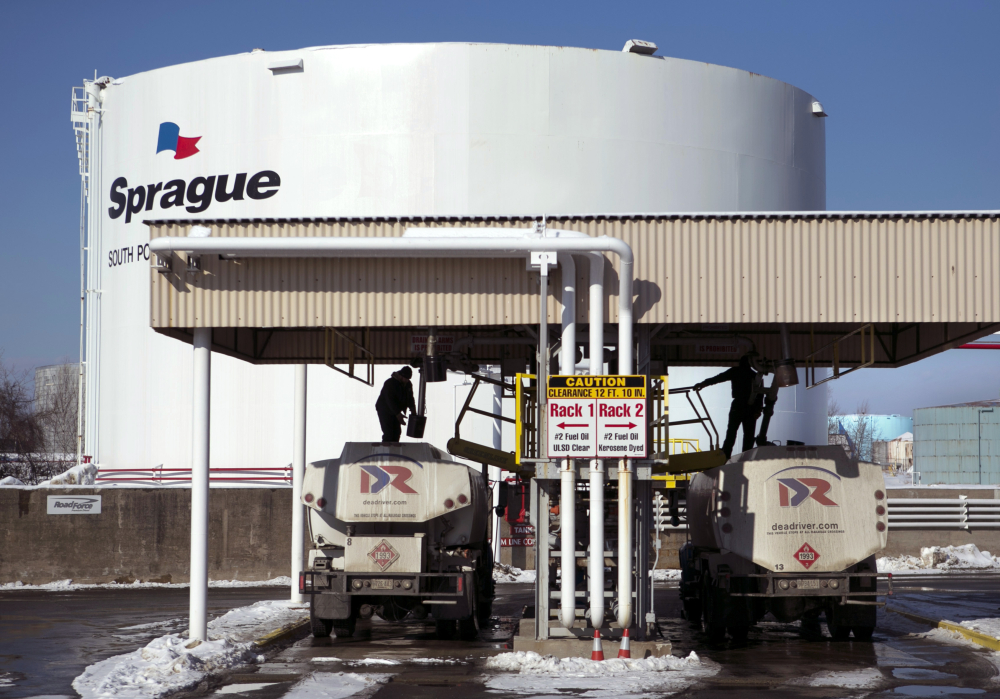 Drivers for an oil delivery company fill their trucks at the Sprague terminal in South Portland. The U.S. Energy Department said Tuesday that heating bills should drop this winter for most U.S. households.