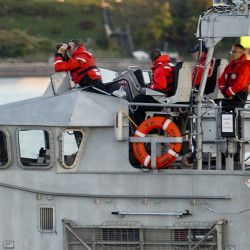 The U.S. Coast Guard looks for a diver who failed to surface near the Portland Fish Pier on Wednesday.