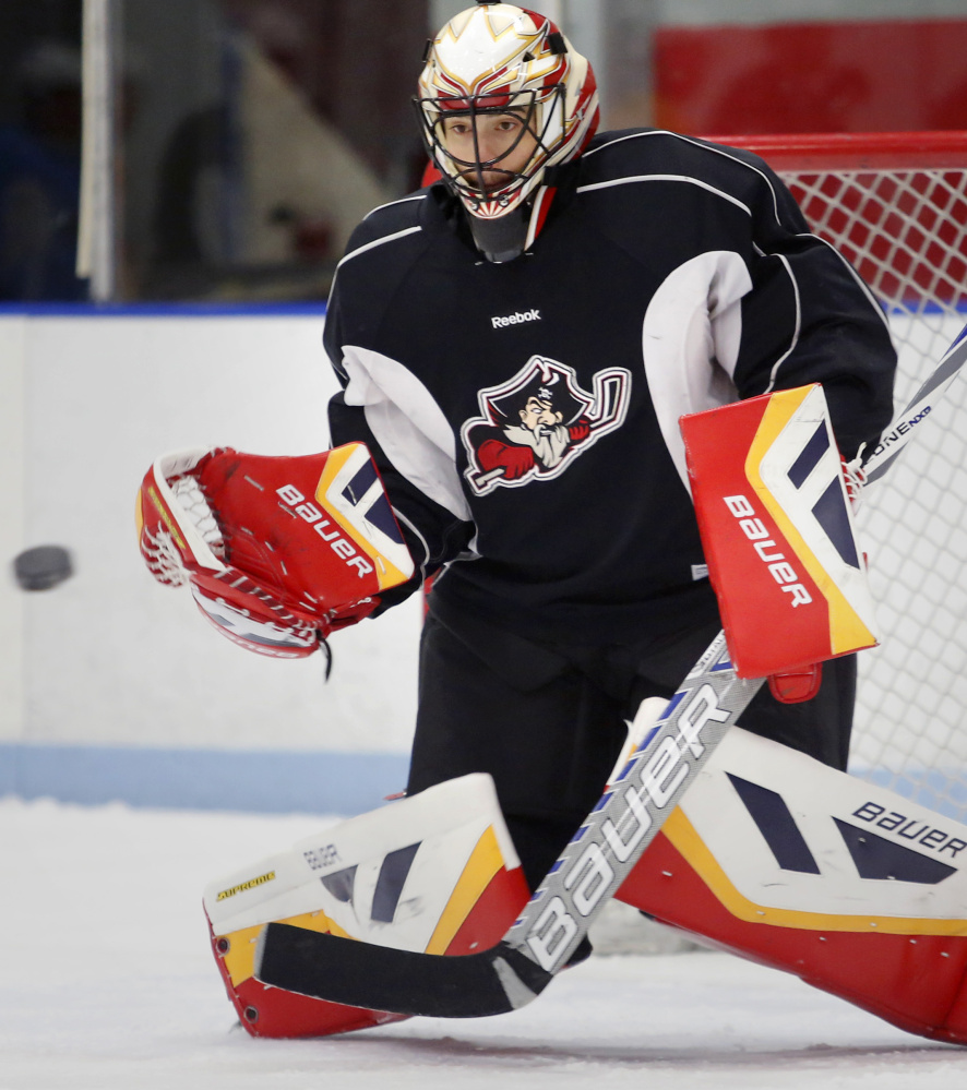 Mike McKenna makes a save during Pirates practice in Saco. The goalie is the lone holdover from last year's team, and will be playing in a Portland uniform under a third NHL affiliate since 2007-08.