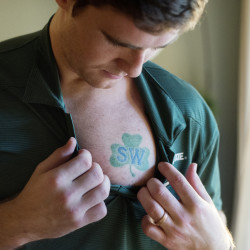 Travis Walsh has a tattoo over his heart of the patch that the University of Maine hockey team wore in honor of their late coach, Shawn Walsh, Travis' father.