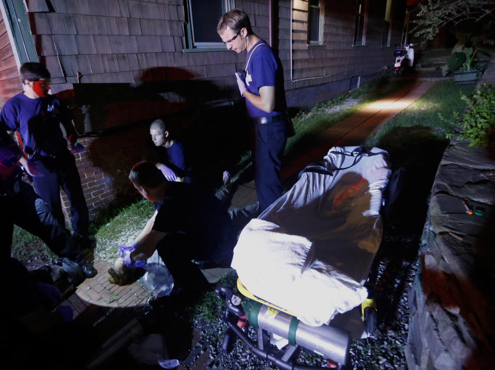 Portland paramedics respond to a call of a heroin overdose on Congress Street in August. Portland Police Chief Michael Sauschuck says that most of the city's crime has some connection to substance abuse.