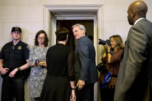 House Majority Leader Kevin McCarthy of California, center, turns to his wife, Judy McCarthy, as they enter a House Republican caucus vote on its nominee to replace House Speaker John Boehner on Thursday on Capitol Hill in Washington. McCarthy withdrew his nomination.