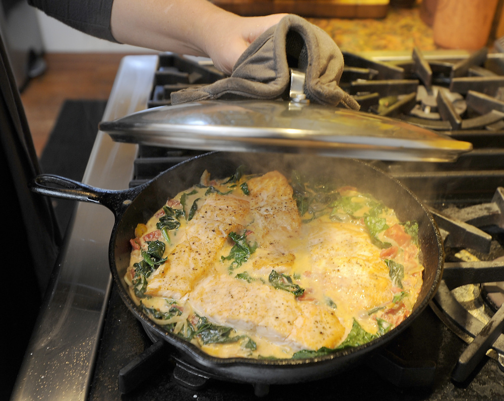 The fish, vegetables and sauce are finished together in one pan.