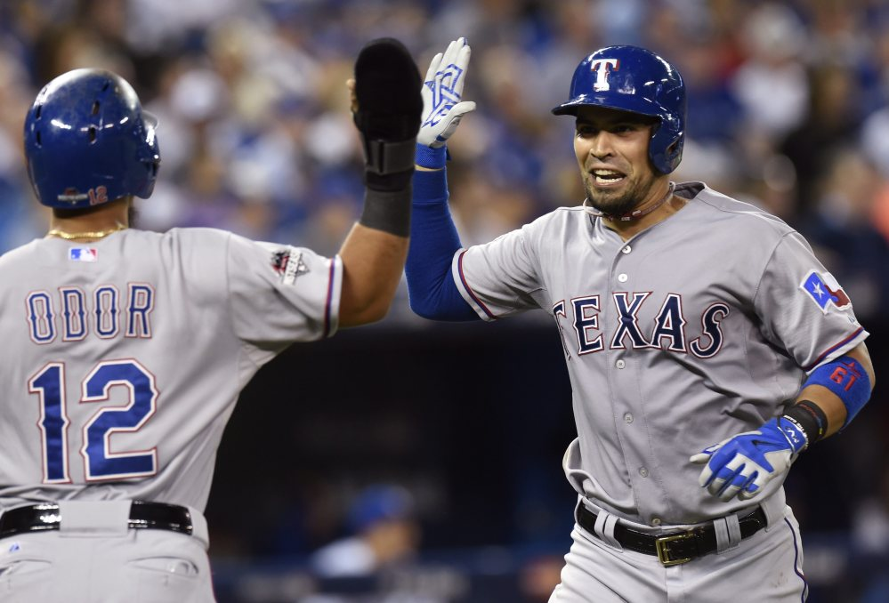The Rangers' Robinson Chirinos, right, is congratulated by teammate Rougned Odor on his two-run home run, which gave Texas a 4-1 lead in the top of the fifth inning of Game 1 of the American League Division Series.