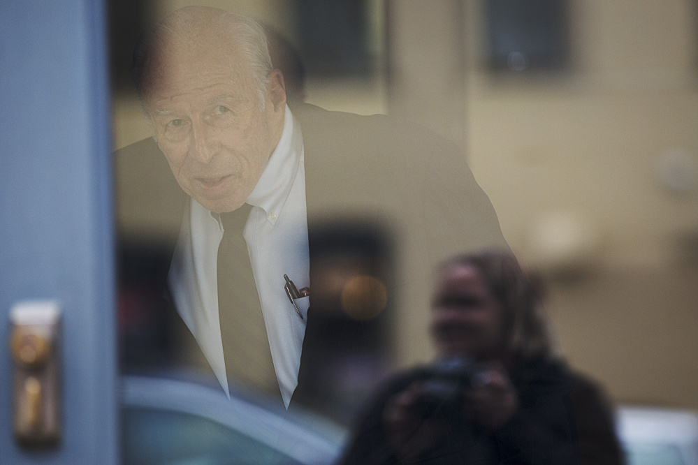 """Russell """"Rusty"""" Brace, 82, looks out the door toward reporters before leaving U.S. District Court in Portland on Friday."""