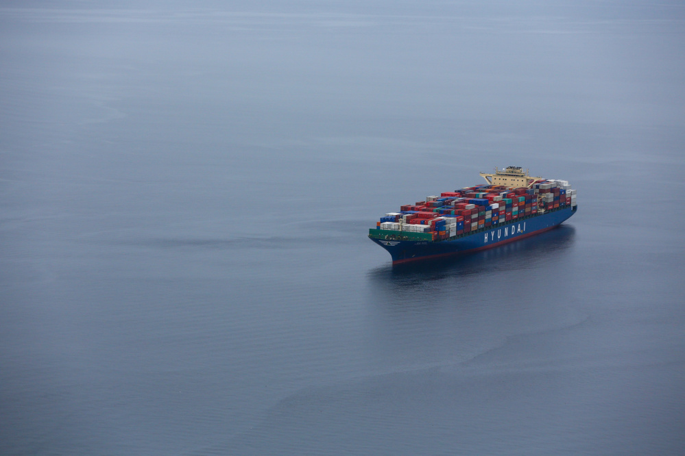 A container ship sits at anchor in Elliott Bay outside the Port of Seattle in February.