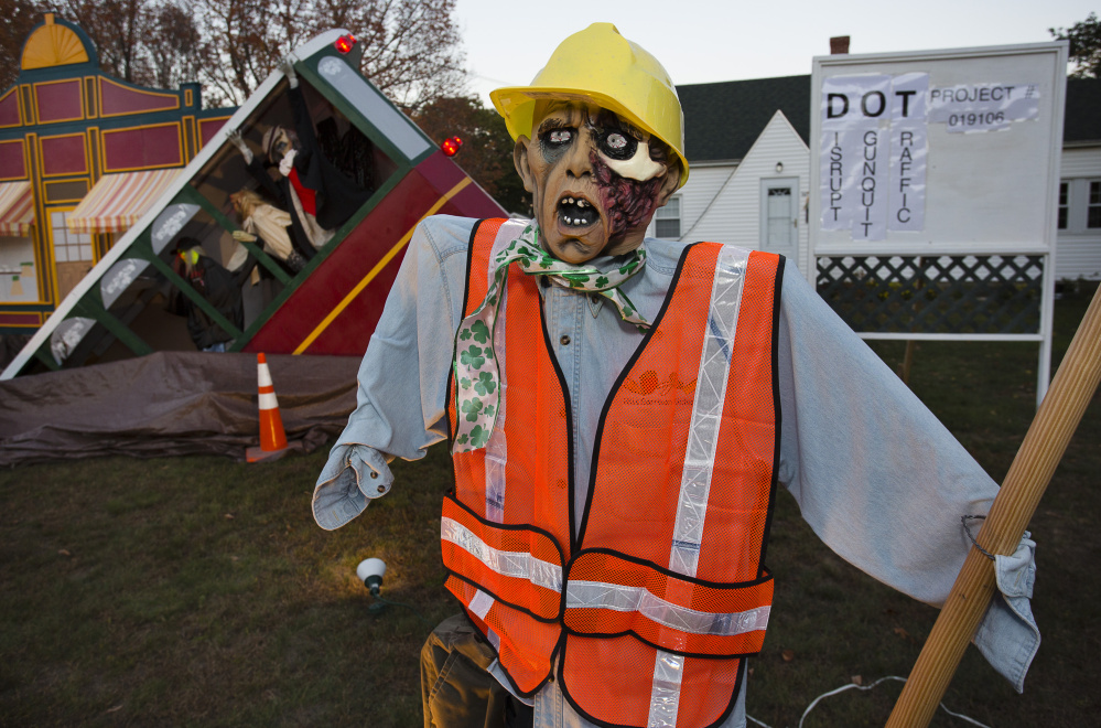 """Even state construction workers are amused by the elaborate Halloween display in Ogunquit. """"I think it's perfectly fine,"""" said Mike Gowen, a laborer on the job site. Carl D. Walsh/Staff Photographer"""