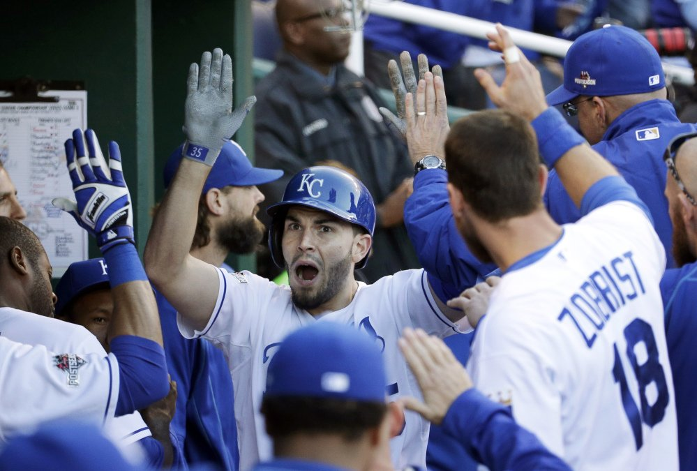 Royals first baseman Eric Hosmer celebrates in the dugout with teammates Saturday after scoring on a single by Mike Moustakas in the seventh inning of Game 2 of the American League Championship Series.