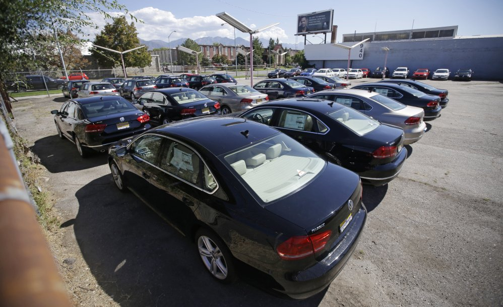 Volkswagen diesel cars are shown are parked in a storage lot near a VW dealership in Salt Lake City. Some legal experts say the automaker could be forced to buy back the cars.