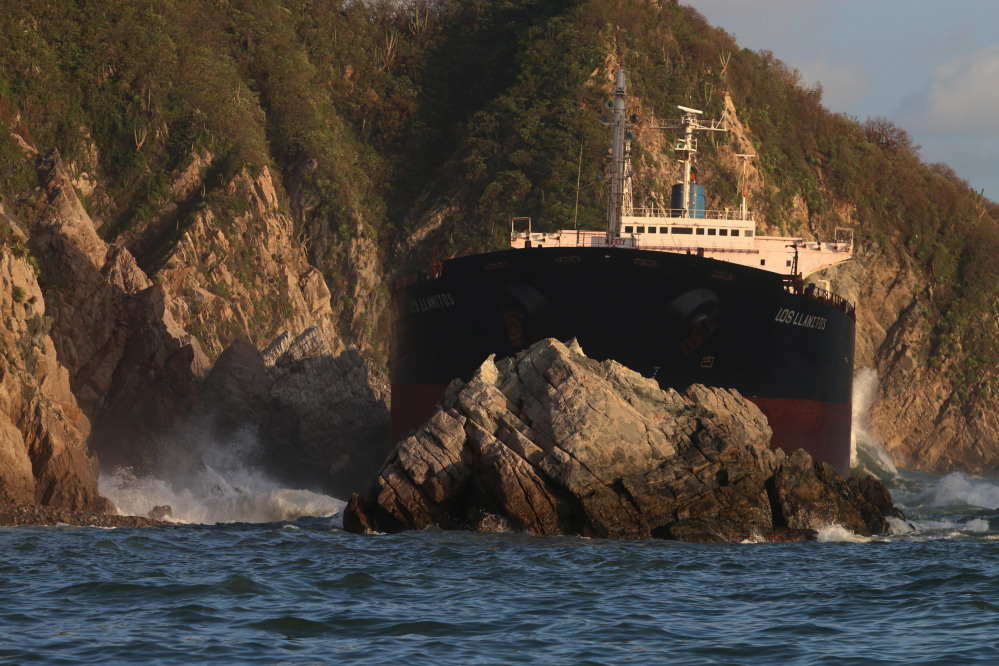 The Mexican cargo ship Los Llanitos is trapped between rock formations after it was dragged and ran aground during the effects of Hurricane Patricia near the town of Barra de Navidad, Mexico, on Saturday.