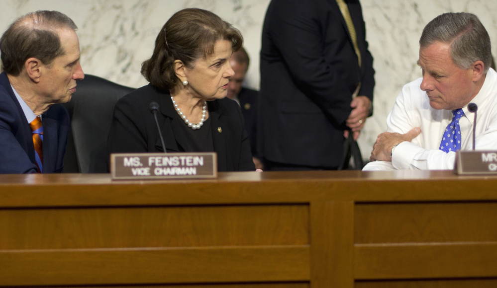 Senate Intelligence Committee Chairman Sen. Richard Burr, R-N.C., confers with committee Vice Chair Dianne Feinstein, D-Calif., and committee member Sen. Ron Wyden, D-Ore. Burr and Fenstein were co-sponsors of the Cybersecurity Information Sharing Act, which the Senate passed Tuesday to encourage the sharing of threat information among companies and the U.S. government.