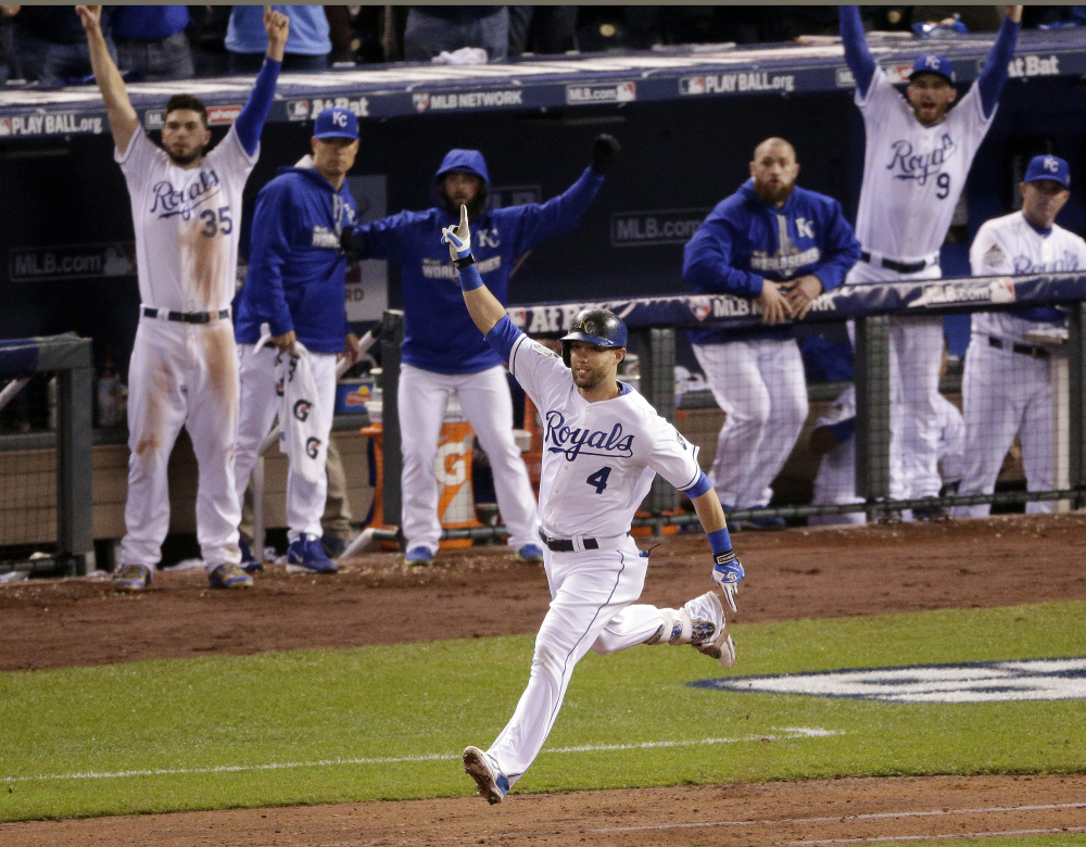 Kansas City's Alex Gordon celebrates the solo home run that tied the game in the ninth inning. The teams played five more innings before the Royals broke the 4-4 tie.