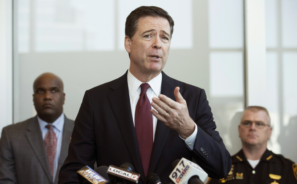 FBI Director James Comey raises the question of whether police officers are easing up on crime fighting for fear of being caught on camera. The Associated Press