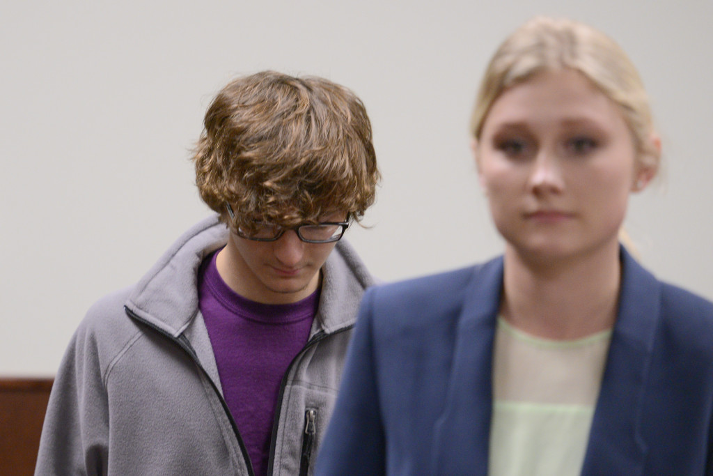 Christopher Leonard appears in court Wednesday to testify against his half sister, Sarah Ferguson, in New Hartford, N.Y. Ferguson is accused of second-degree assault for allegedly beating the 17-year-old during an attack at church. The woman at his right was not identified.
