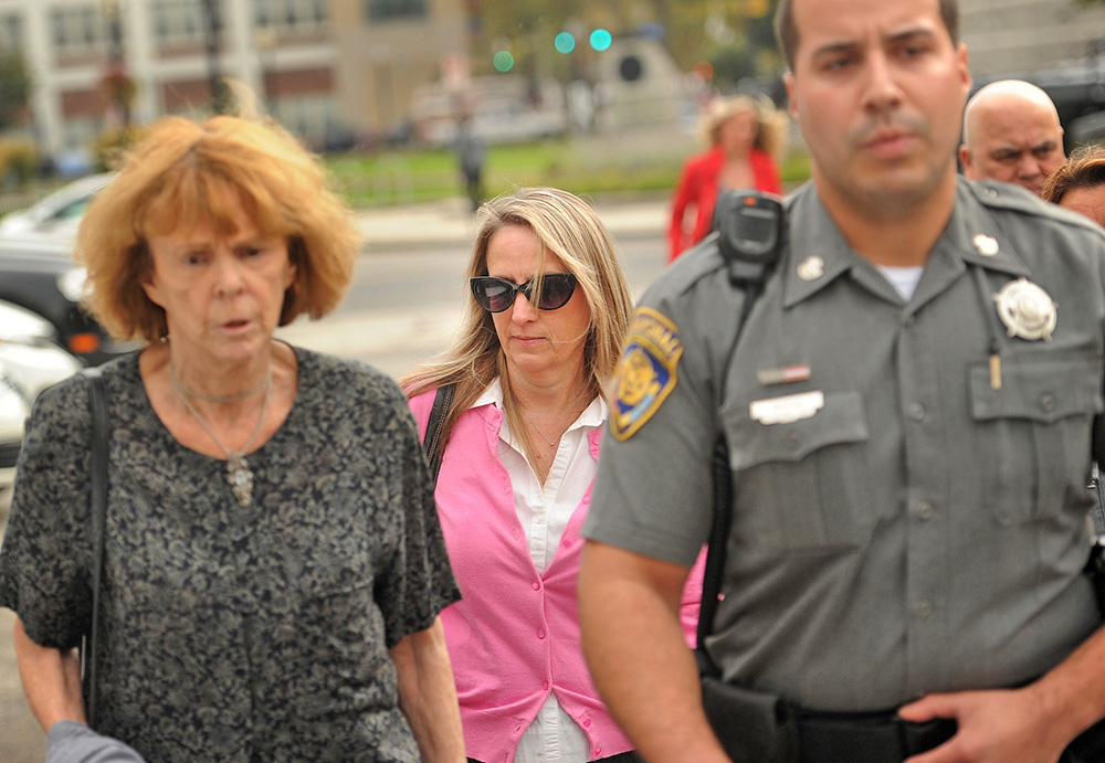 Jennifer Connell, center, is escorted to her car by marshals Tuesday after a jury ruled that her nephew was not liable for  injuries she suffered when he greeted her enthusiastically at his 8th birthday party four years ago. Brian A. Pounds/Hearst Connecticut Media via AP