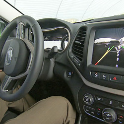 An electronic display for parallel parking assistance occupies a dominant position on the dashboard in this late-model American vehicle. The Associated Press