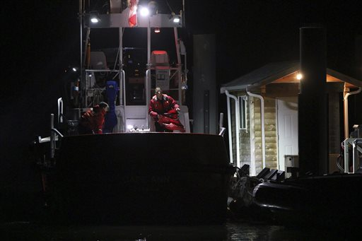 Canadian Coast Guard crew arrive at a dock in Tofino, west coast of Vancouver, Canada, early Monday following a search and rescue operation for people who were on board a whale watching boat when it sank off Vancouver Island on Sunday. The Associated Press