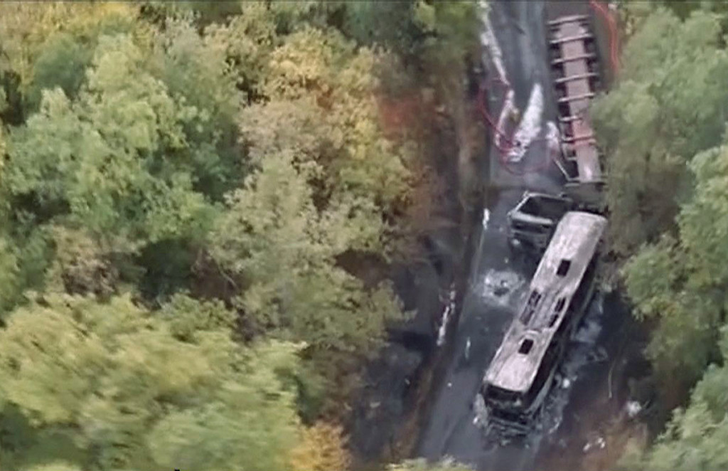 This image taken from video shows the scene after a truck and a bus transporting retirees on a day trip collided and caught fire Friday in southwest France, killing 43-people. Télé FRANCE TV via AP