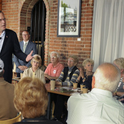 Former Florida Governor and Republican presidential candidate Jeb Bush answers questions during a meet and greet Wednesday, at Elly's Tea and Coffee in Muscatine, Iowa. Beth Van Zandt/Muscatine Journal via AP