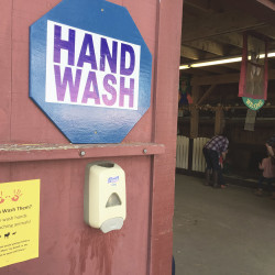 A hand-washing station is mounted outside a barn at the petting zoo at the Fryeburg Fair on Wednesday. It's still unclear whether the petting zoo at the Oxford County Fair was the root cause of the E. coli infections that killed one toddler and sent another to the hospital.
