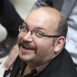 ason Rezaian, an Iranian-American reporter for the Washington Post, attends a presidential campaign event for President Hassan Rouhani in Tehran, Iran, in this FILE - In this photo April 11, 2013, photo. The Associated Press