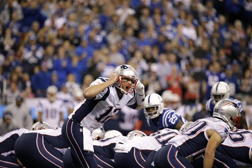 New England Patriots quarterback Tom Brady yells on the line of scrimmage in the first half of an NFL football game against the Indianapolis Colts in Indianapolis, Sunday, Oct. 18.  (AP Photo/John Minchillo)