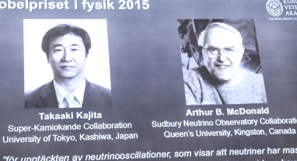 The winners of the Nobel prize in physics are projected on a screen at the Nobel Assembly on Tuesday. The Royal Swedish Academy of Sciences says Takaaki Kajita of Japan and Arthur McDonald won the prize  for their discovery of neutrino oscillations. The Associated Press
