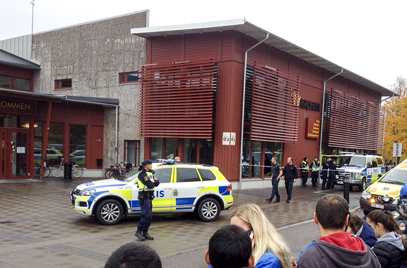 Emergency services attend the scene after a masked man attacked people with a sword at the Kronan school in Trollhattan, near Goteborg in western Sweden, on Thursday. The Associated Press