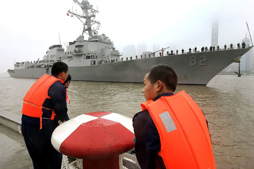 Chinese navy personnel get ready for U.S. Navy guided missile destroyer USS Lassen to dock at the Shanghai International Passenger Quay for a scheduled port visit in this 2008 photo. The USS Lassen sailed past one of China's artificial islands in the South China Sea on Tuesday in a challenge to Chinese sovereignty claims that drew an angry protest from Beijing, which said the move damaged U.S.-China relations and regional peace. The Associated Press