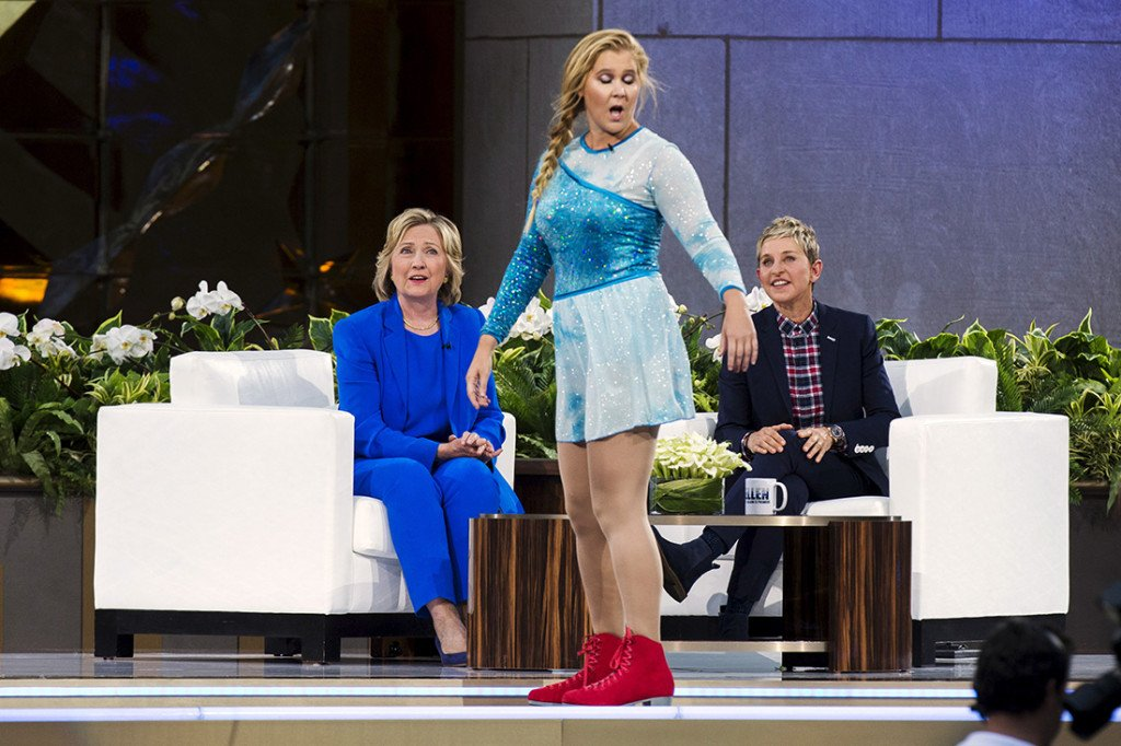 """Presidential candidate Hillary Clinton and television host Ellen DeGeneres watch Amy Schumer during a taping of """"The Ellen DeGeneres Show"""" recently. Reuters"""