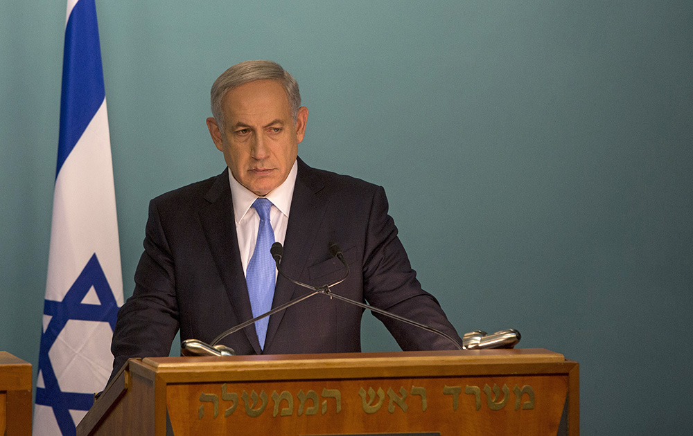 Israeli Prime Minister Benjamin Netanyahu addresses the news media with United Nations Secretary-General Ban Ki-moon at the prime minister's office in Jerusalem on Tuesday. Netanyahu's Holocaust comments come at a sensitive time, as he is scheduled to travel to Berlin today to meet German Chancellor Angela Merkel. The Associated Press