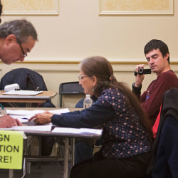 A man who would only identify himself as Andrew videotapes people as they sign petitions after voting at the Irish Heritage Center in Portland on Tuesday. Members of the group Project Dirigo said they were videotaping petition gathering to ensure it was conducted legally and also asked the people gathering the signatures for their names and addresses.