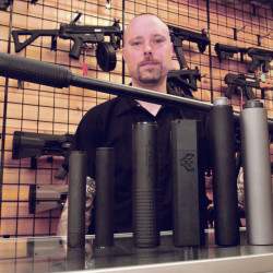 Adam Hendsbee, owner of A & G Shooting Supply in Fairfield, talks in his shop Wednesday about the variety of silencers that are now legal to have installed on firearms.