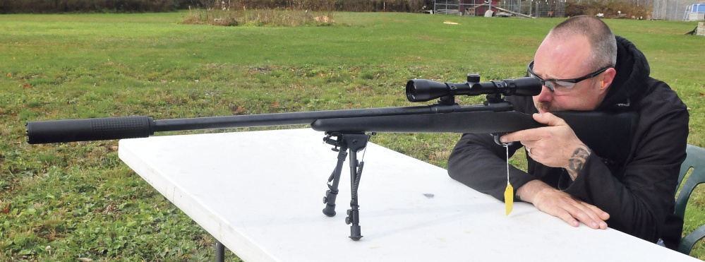 Adam Hendsbee Takes Aim While Firing A 308 Caliber Rifle With Silencer Attached