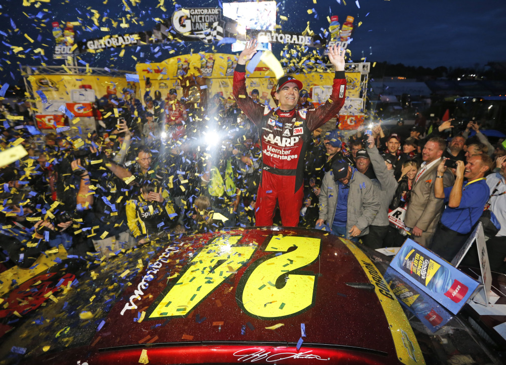 Jeff Gordon celebrates after winning the NASCAR Sprint Cup Series auto race Sunday at Martinsville Speedway in Martinsville, Va.