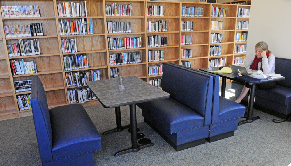 Susan Onion finds a quiet table to get some work done on Friday at C.M. Bailey Public Library in Winthrop.
