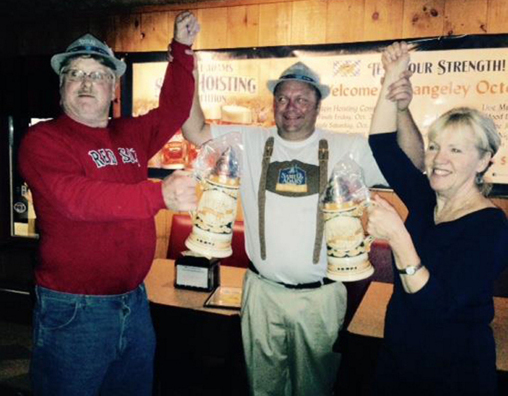 Mickey Bechard, center, with stein winners, Rusty Shorey, men's category, left, and Sue Lind, women's category, right.