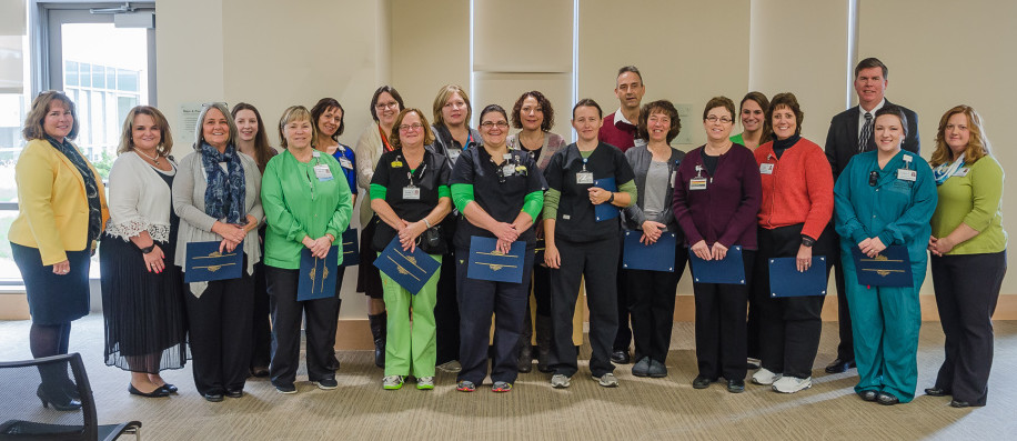 Flanking the nurses who earned certificates in front line leadership are, at left, Commissioner Jeanne Paquette of the Maine Department of Labor and Jennifer Riggs, chief nursing officer at MaineGeneral. At right is Jennifer Boynton,  coordinator, Staffing & Resource Management at MaineGeneral, and third from right in back, Chuck Hays, CEO, MaineGeneral Health. Nurses who earned apprenticeship certificates, beginning third from left, are Kathleen Clark, Amy Adams, Janice Tillson, Tina Stubbert Roy, Margaret Almand, Ellen Treadwell, Elizabeth Doyen, Mary Rogers, Sherry Collins, Naomi Miller, Rick Haase, MaryAnn Constanzer, Susan McDonald, Karen Takatsu, Lisa Snow-Manelick, Janet Peacock.