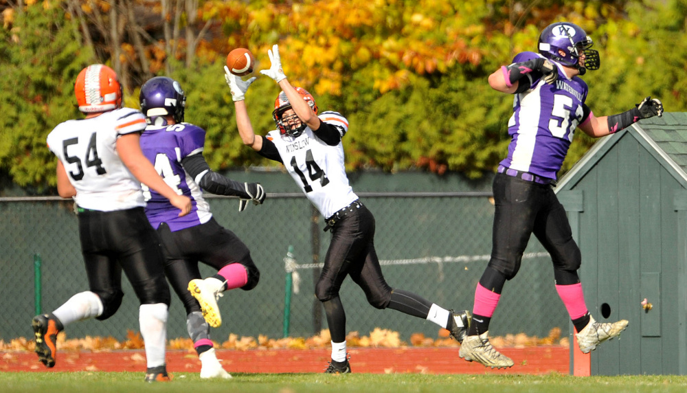 Winslow's Dylan Hutchinson (14) hauls in a two-point conversion pass during the regular season finale with Waterville last month. The Raiders return to action this Saturday against MDI in a Big Ten Conference semifinal.
