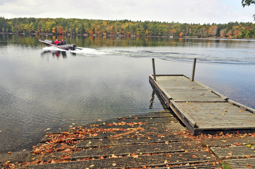 Dan Roy Sr. and Dan Roy take off for a day of bass fishing last month on Cochnewagon Lake in Monmouth, where voters on Tuesday approved spending money on improvements.