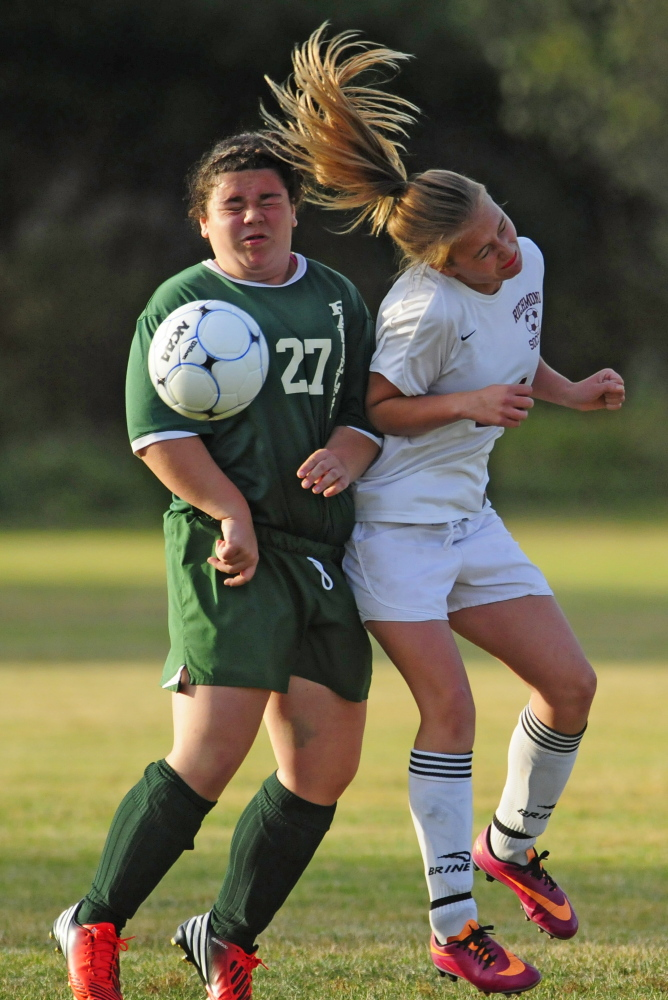 Rangeley's Mary Page Swiney, left, and Richmond's Jade Gammon collide during a Western D playoff game last season in Richmond. The teams meet again at 2 p.m., today in the Class D South regional final.