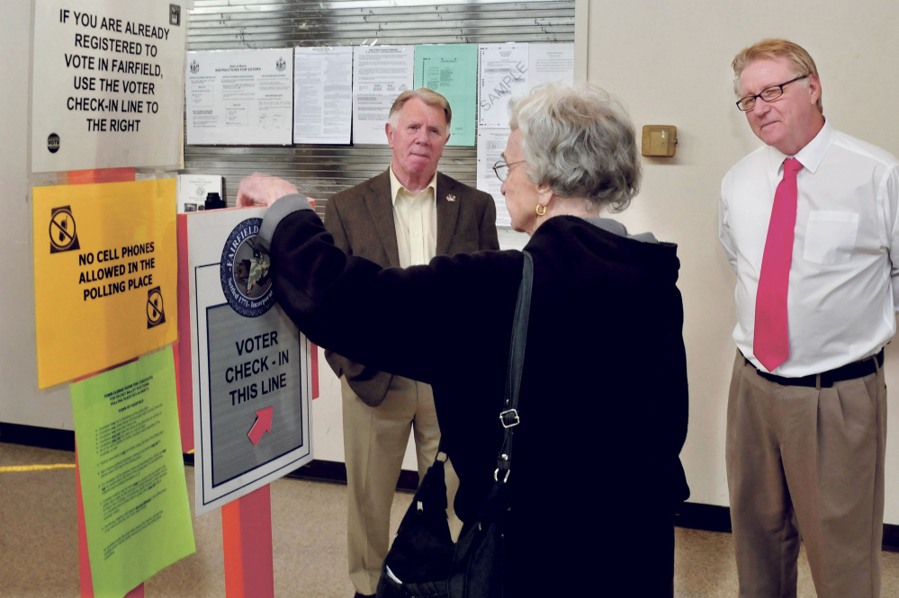 Fairfield council candidates John Picchiotti, left, and Harold Murray speak with Fairfield voter Gloria Champine before she voted on Tuesday. Picchiotti was re-elected to a three-year term despite anti-Muslim posts on his private Facebook page, which has since been taken down. Murray came in third in the race for two seats.