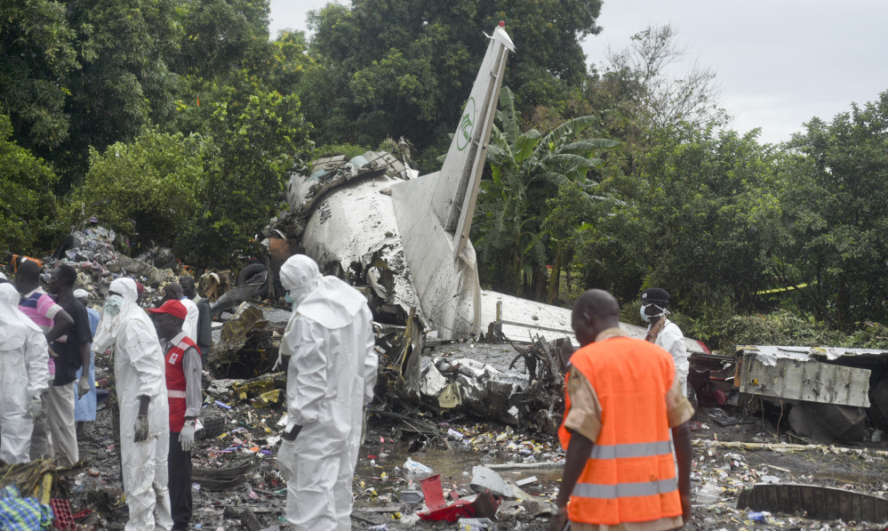 Responders pick through the wreckage of a cargo plane which crashed in the capital Juba, South Sudan Wednesday.